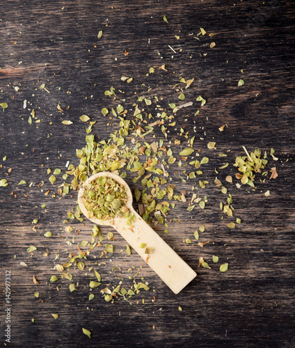 Dried marjoram spice on wood background,Origanum majorana - 142997332