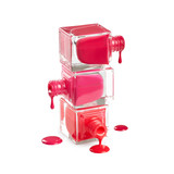 Nail polish dripping from stacked bottles