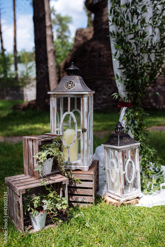 Beautiful wedding ceremony outdoors. Decorated chairs stand on the ...