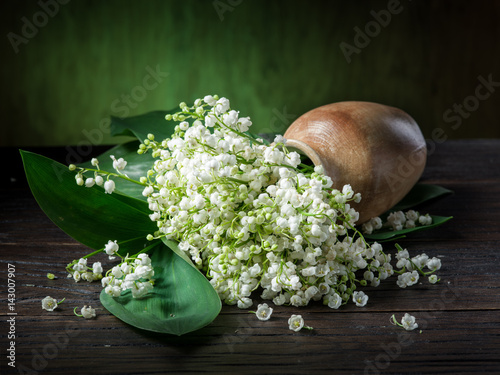 Fotobehang Lelietjes van dalen Lily of the valley bouquet on the wooden table.