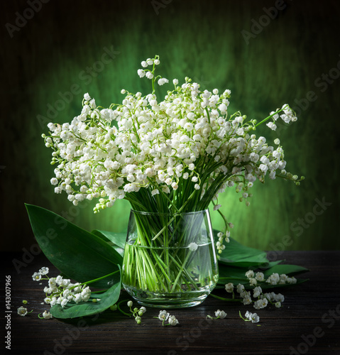 Lily of the valley bouquet on the wooden table. Poster