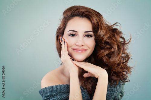 Foto Murales Beautiful Smiling Model Woman with Wavy Hairstyle. Cosmetology and Treatment Concept