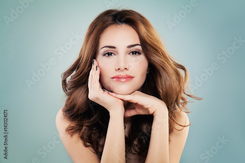 Smiling Model Woman with Perfect Skin and Red Curly Hairstyle. Cosmetology Concept