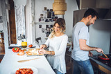 Man and woman cooking - 143027105