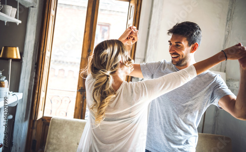 Cheerful couple dancing and laughing