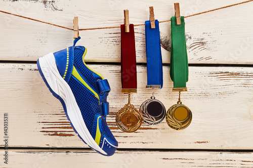 Poster Sneakers and medals. Work hard, dream big.