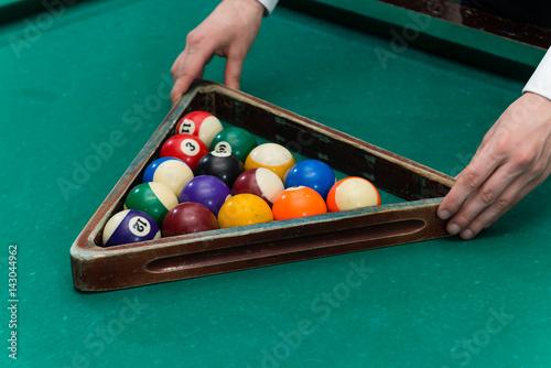 Staande foto Billiards pool frame with balls in the hands