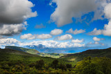 Sicilian landscape of blue sky, clouds and green Mountains and hills