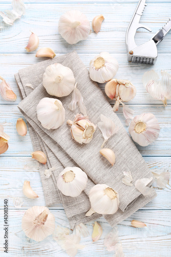 Garlic with napkin on blue wooden table
