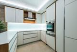 White kitchen in modern apartment interior - 143085361