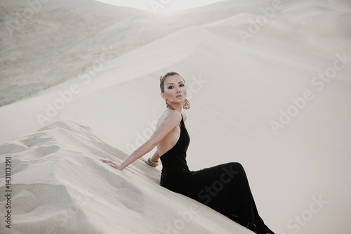 Plakat Fashion photo of beautiful sexy asian woman in desert