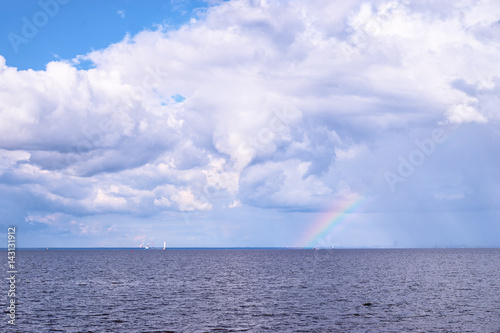 Beautiful seascape. Rainbow on horizon.