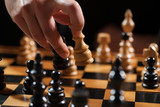 Close up image of man who is making move in chess game.  - 143132394
