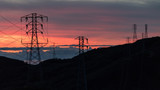Sunset over Ocean Mountains Shape of Silhouette Electric Powerlines Towers - 143138148