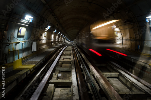 In de dag Metro subway of Turin (Italy) with dark tunnel and a train moving fast