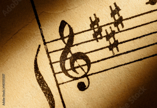 treble clef on old music sheet