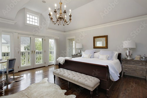 Master bedroom with doors to balcony