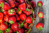 Fresh strawberries in the basket, fruits on farmer market table - 143164126