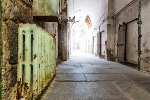 Poster Old prison hallway.
