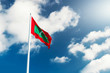 National flag of Republic of Maldives at blue cloudy sky - 143181187