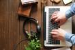 Wooden desktop with laptop, books and headphones