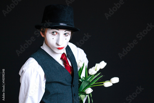 Mime hides bouquet of white tulips behind his back Poster