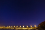 Starry sky above the highway with night lighting.