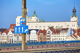 Street signs by the Castle route, main Szczecin city entrance highway with old town in distance, Poland.