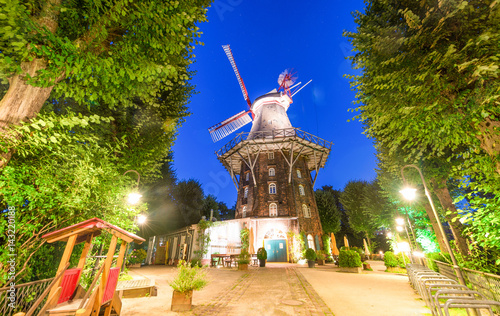 Wallanlagen with windmill at night in Bremen, Germany