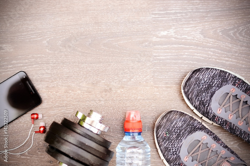Ready for training, fitness items on dark wooden background