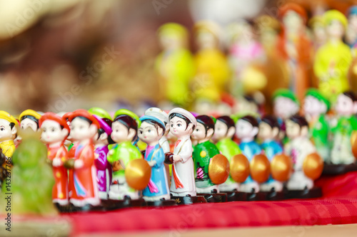 Poster Vietnam's traditional souvenirs are sold in shop at Hanoi's Old Quarter ( Pho Co