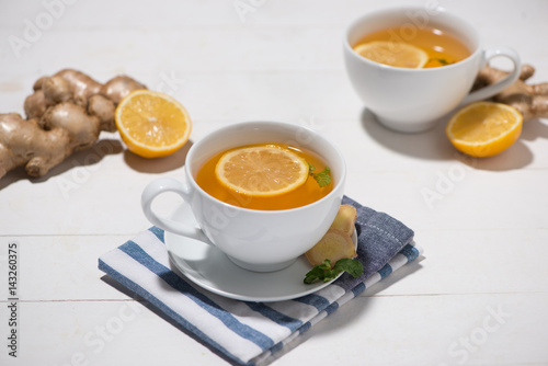 Cup of Ginger Tea with Lemon and Honey on a White Wooden Background Poster