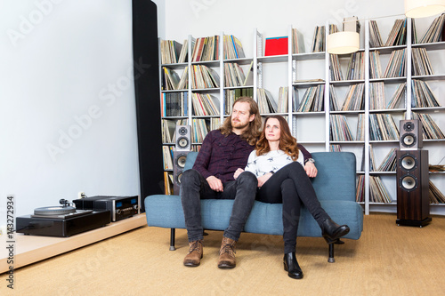 a couple on the sofa listening to music