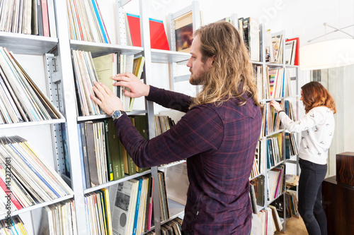 a couple choosing an album out of their collection