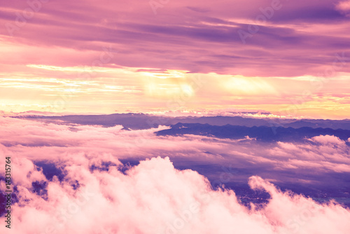 Fotobehang Candy roze High angle view. Cloud mountain sky. Evening light