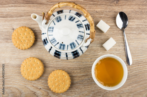 Poster Tea, round cookies, teapot, lumpy sugar and spoon