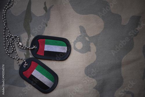 Aluminium Abu Dhabi army blank, dog tag with flag of united arab emirates on the khaki texture background. military concept