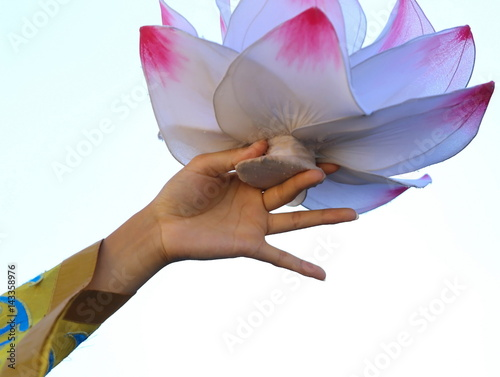 delicate lotus flower supported by the hands of the dancer Poster