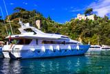 Luxury white yacht in harbour of Portofino, Italy