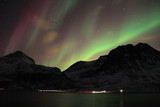 Northern lights reflected in seawater. Tromso, Norway.