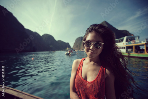 Poster Women travelers were traveling to Phuket Phi Phi Island in the summer