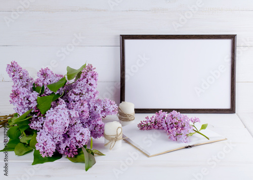 Lilac Bouquet in clay jug with motivational frame  for your text or picture Photo by julia_arda