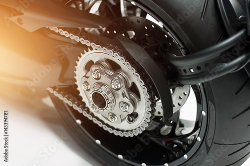 detail of a motorcycle rear chain and gear