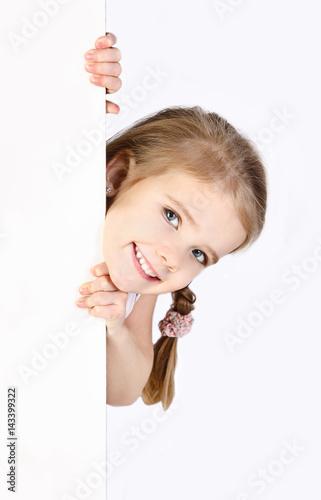 Fotografiet Smiling cute little girl isolated