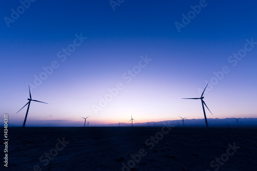 wind turbines in field at twilight Poster