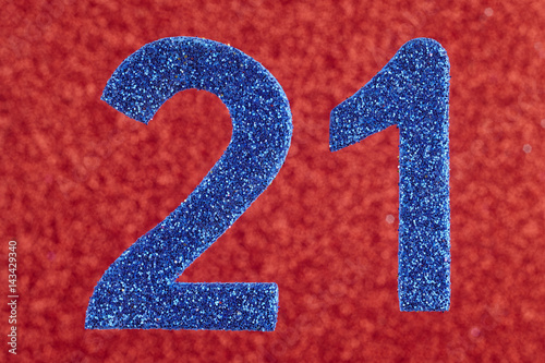 Poster Number twenty-one blue over a red background. Anniversary.