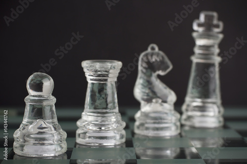 Poster Glass chess team: king, pawn, knight and rook