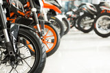 Fototapety Wide variety. Cropped shot of motorbikes on an exhibition at the motorcycle salon