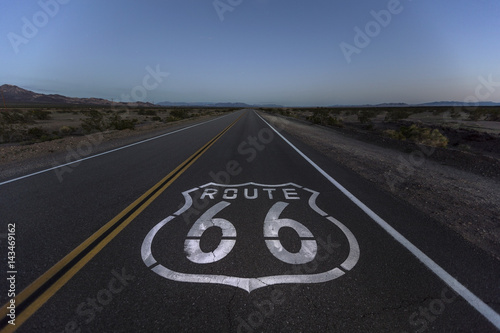 Poster Route 66 pavement sign and desert dusk near Amboy California.