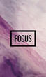 Focus motivational quote on abstract liquid background.